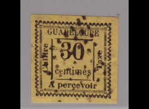 Guadeloupe: 1876, Portomarke 30 C. schwarz auf gelb (seltene breitrandige farbfrische Marke, leider kleine Nadelstiche, M€ 200,-)